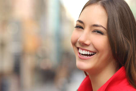 Foto per Woman white smile with a perfect teeth in the street and looking at camera - Immagine Royalty Free