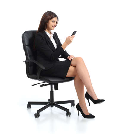 Photo pour Executive business woman using a smart phone sitting on a chair isolated on a white background - image libre de droit