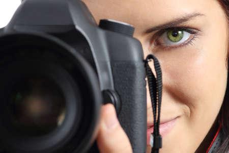 Foto de Close up of front view of a photographer woman eye photographing with a dslr camera - Imagen libre de derechos