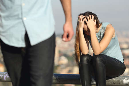 Photo pour Breakup of a couple with bad guy and sad girlfriend with a city in the background - image libre de droit