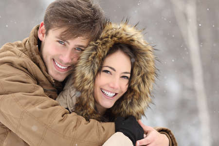 Photo pour Couple laughing with a perfect smile and white teeth and looking at camera in winter holidays - image libre de droit