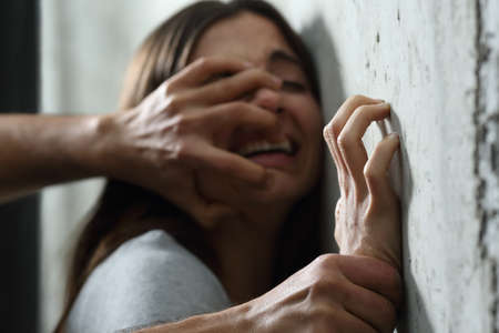 Photo pour Sexual abuse with a man attacking to a scared woman in a dark place - image libre de droit