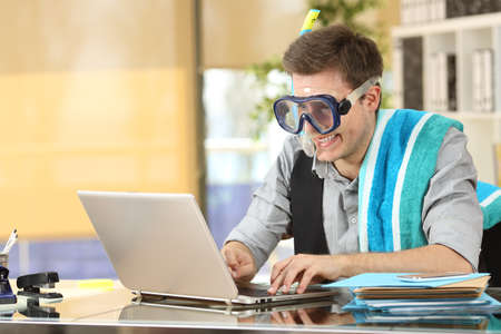 Photo for Businessman working on line or searching travel destinations with goggles needing vacations at office - Royalty Free Image