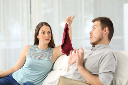 Photo pour Wife finds panties on a sofa and discovers that her husband is cheating - image libre de droit