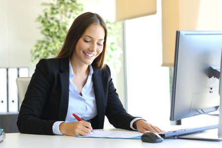 Photo pour Happy businesswoman signing a contract or document in a desk at office - image libre de droit