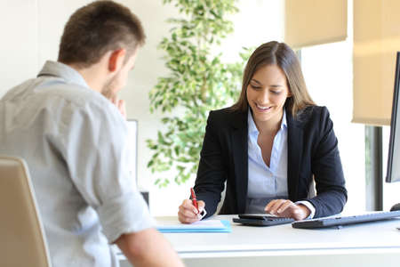 Photo pour Happy professional agent and customer calculating budget at office - image libre de droit