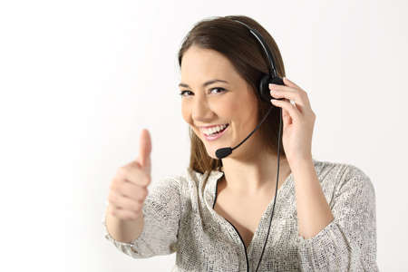 Photo for Portrait of a phone operator looking at you and gesturing thumbs up on a white background - Royalty Free Image