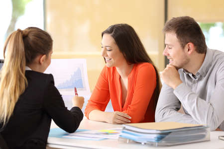 Photo for Happy businesspeople talking about earnings during an audit at office - Royalty Free Image