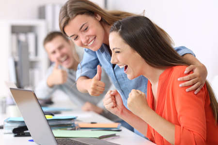 Photo for Happy employee being congratulated by colleagues after success at office - Royalty Free Image