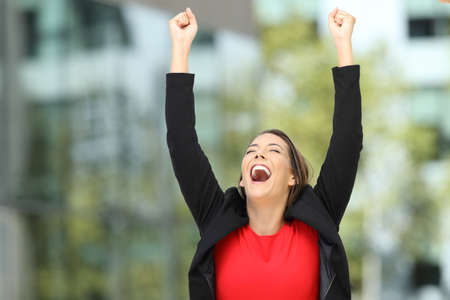 Photo for Single excited executive raising arms after success on the street - Royalty Free Image