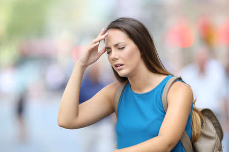 Photo for Single woman suffering headache outdoors in the street - Royalty Free Image