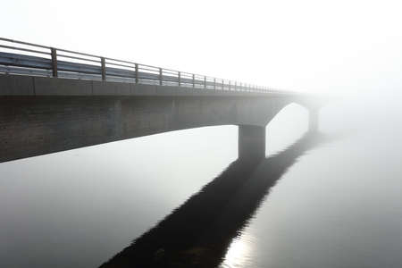 Photo for Concrete bridge over the sea in the middle of a deep fog - Royalty Free Image