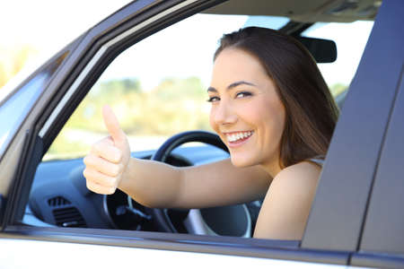 Photo for Portrait of a satisfied driver gesturing thumbs up sitting inside a car - Royalty Free Image