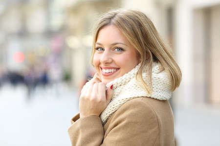 Photo for Portrait of a happy woman posing looking at camera in winter in the street - Royalty Free Image