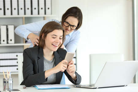 Photo for Furious office worker angry with her lazy colleague trying to strangle - Royalty Free Image