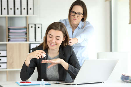 Photo for Angry partner trying to kill to her lazy colleague at office - Royalty Free Image