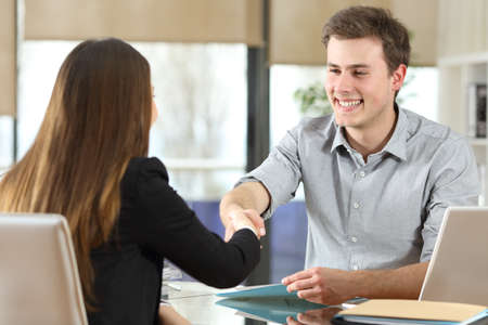 Photo for Happy businesspeople handshaking after negotiation at office - Royalty Free Image