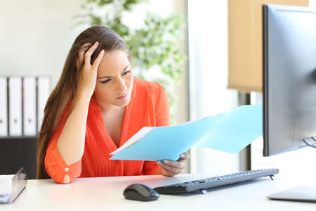 Photo for Worried busnesswoman complaining after discover mistake on document at office - Royalty Free Image