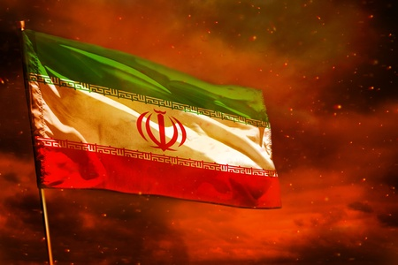Photo for Fluttering Iran flag on crimson red sky with smoke pillars background. Iran problems concept. - Royalty Free Image