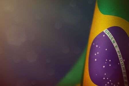 Foto de Brazil hanging flag for honour of veterans day or memorial day on blue dark velvet background. Brazil glory to the heroes of war concept. - Imagen libre de derechos