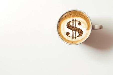 Foto de cup of coffee cappuccino with a picture of a dollar sign from cinnamon on milk foam - Imagen libre de derechos