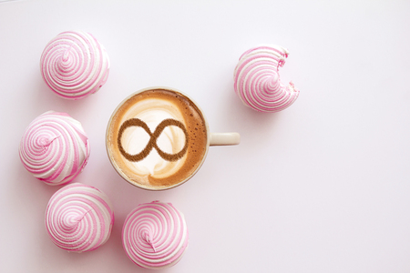 Photo for a cup of cappuccino coffee with a symbol of the symbol of infinity on milk foam - Royalty Free Image