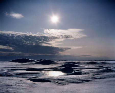 little lake of fresh water on surface of pack ice floe, Arctic ocean