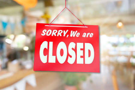 Photo pour A Sign board of sorry we are closed hang on door of business shop with nature green background - image libre de droit