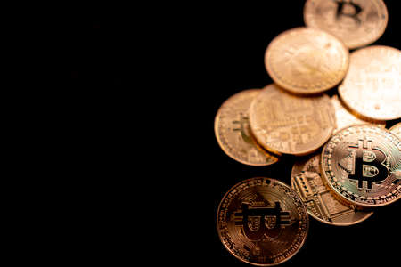 Photo pour Stack of bitcoins symbol of digital money as cryptocurrency with black background with copyspace that you can put text on. - image libre de droit