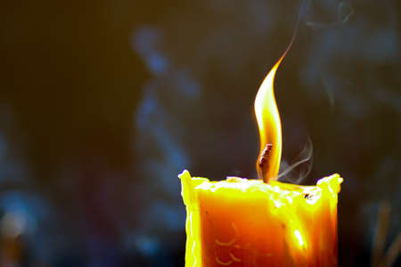 Foto de One light candle burning brightly - Imagen libre de derechos