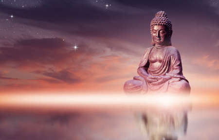 Photo pour Buddha statue sitting in meditation pose against sunset sky with golden tones clouds. - image libre de droit