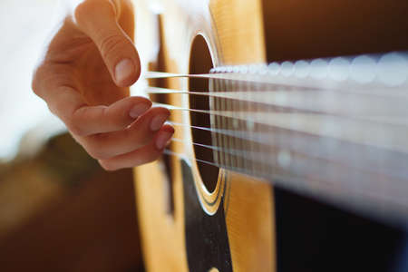 Photo for play acoustic guitar, close up of the hands - Royalty Free Image