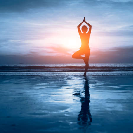 Foto de wellness concept, beautiful silhouette of woman practicing yoga - Imagen libre de derechos