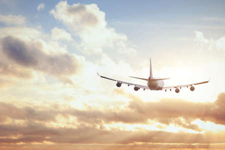 Photo pour airplane in sunset sky - image libre de droit