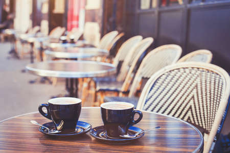 Photo for street cafe in Europe, two cups of coffee on cozy vintage terrace - Royalty Free Image