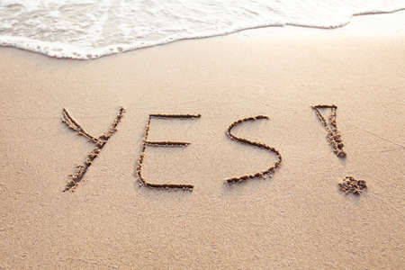 Photo pour YES concept, positive changes in the life, word written on sand beach - image libre de droit