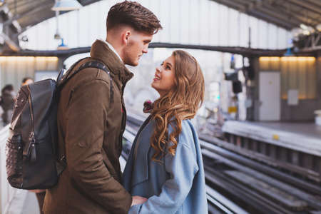Photo pour long distance relationship, couple on platform at the train station, meeting or parting concept - image libre de droit