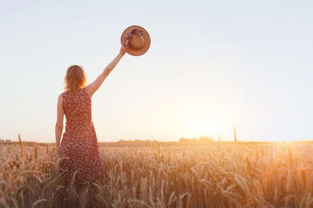 Photo pour goodbye or parting background, farewell, woman waving hand in the field - image libre de droit