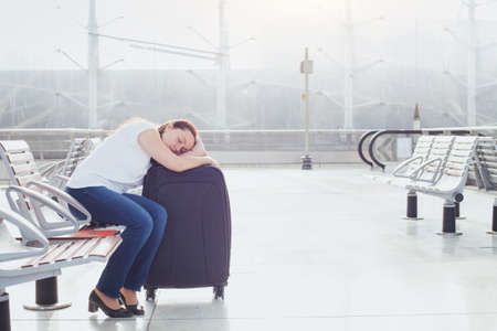 Photo for woman sleeping in the airport, transit passenger - Royalty Free Image