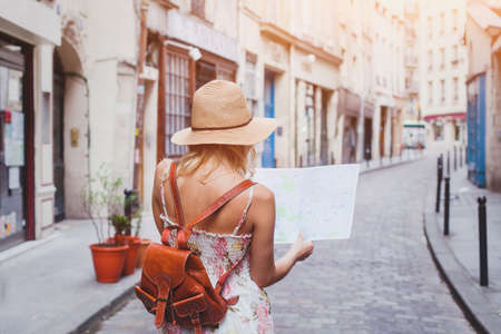 Photo pour travel guide, tourism in Europe, woman tourist with map on the street - image libre de droit