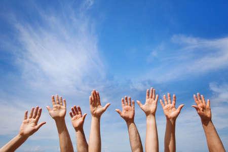 Photo pour Volunteering concept, hands of group of people volunteers in blue sky - image libre de droit