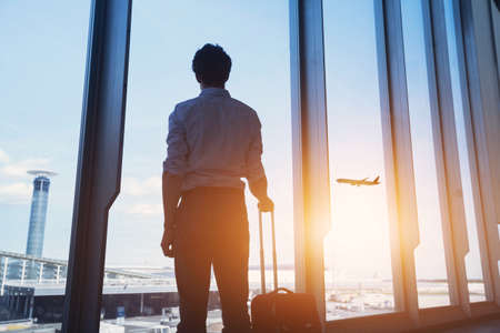 Photo for travel concept, business man silhouette in airport - Royalty Free Image