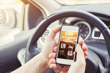 Foto de car insurance concept, driver reading website on smartphone - Imagen libre de derechos