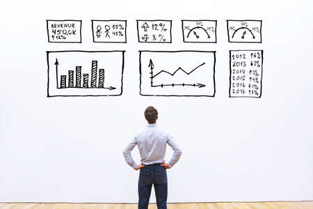 Foto de business analytics concept, businessman looking at dashboard with charts and graphs - Imagen libre de derechos