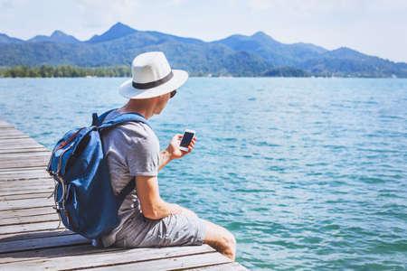 Foto für tourist traveler using mobile phone, smartphone app for traveling - Lizenzfreies Bild