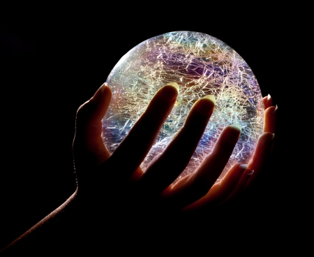 Photo pour Hands holding a glowing colorfull glass or crystal ball - image libre de droit