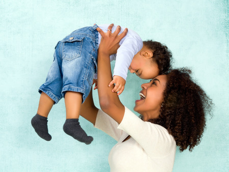 Photo for African mother playing with her 11 months old son - Royalty Free Image