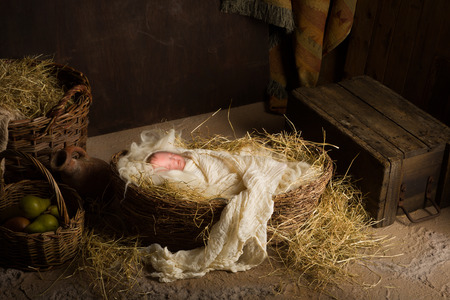 Photo pour Baby doll acting as Jesus in a Christmas Nativity scene - image libre de droit