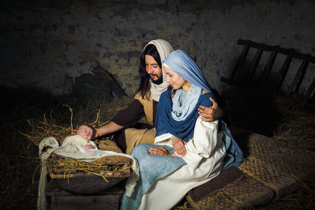 Photo for Live Christmas nativity scene in an old barn - Reenactment play with authentic costumes.  The baby is a (property released) doll. - Royalty Free Image