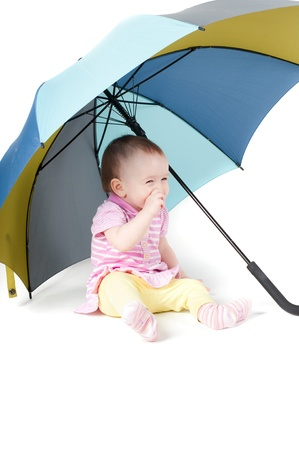 Cute baby girl under umbrella